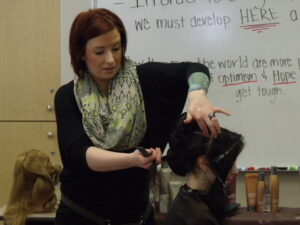 Woman cutting hair at Xenon Academy
