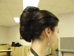 Woman with dark hair pulled back
