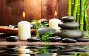 Spa, with stacked rocks and lit candles