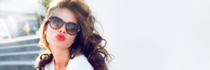 Woman with summer sunglasses and curly hair