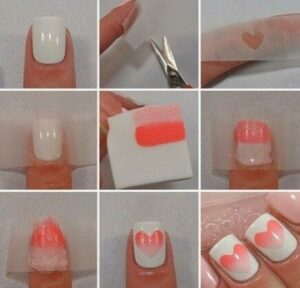 White nails with pink nail art