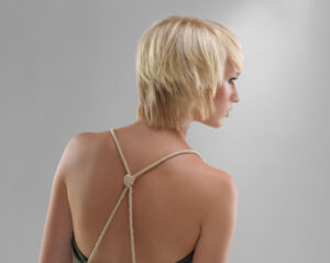 A model with short blonde hair