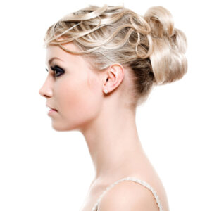Profile view of fair maiden sporting blonde bun hairstyle