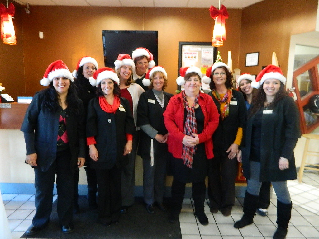 Santa Hats on our staff! Happy Holidays!