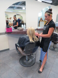 Xenon Academy Student doing hair