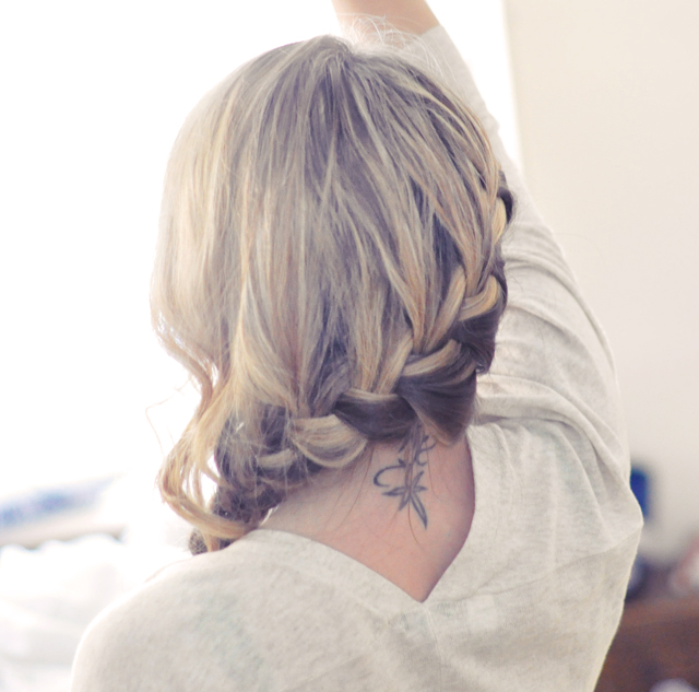 Girl with braids and neck tatoo