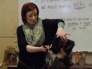 Woman cutting hair at Xenon Academy
