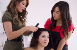 two woman cutting a gals hair