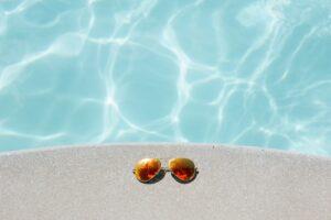 glasses near the pool