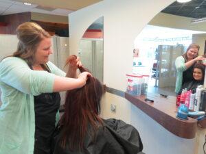 Sam styling hair at Xenon Academy