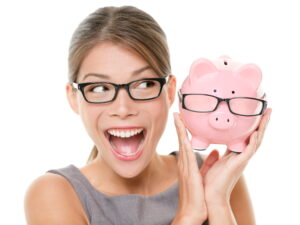 Happy woman with nerdy piggy bank