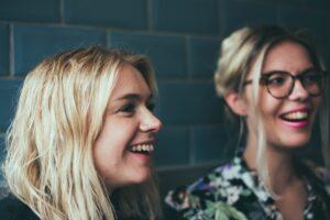 two women laughing and having fun