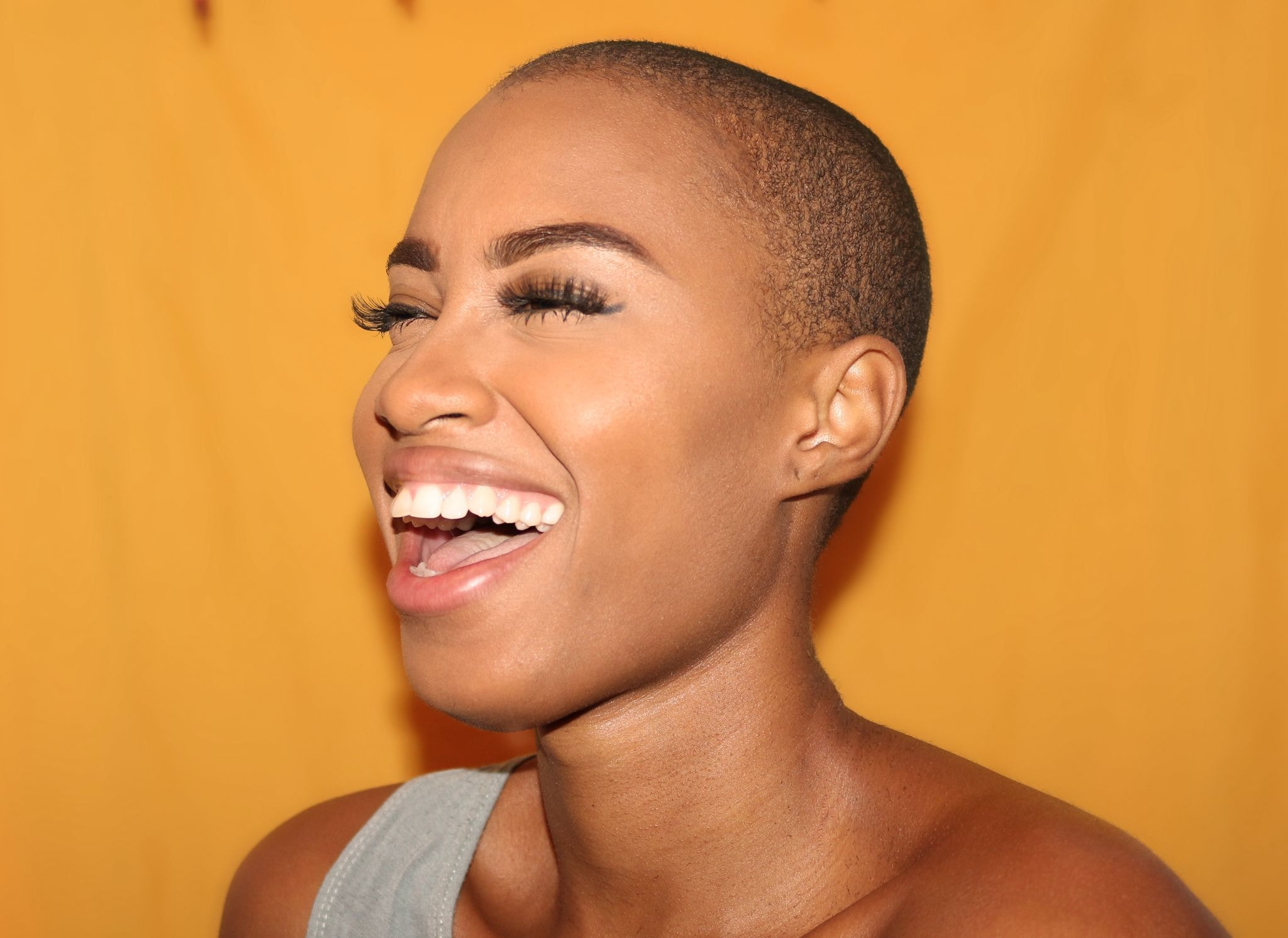 black woman with beautiful skin laughing