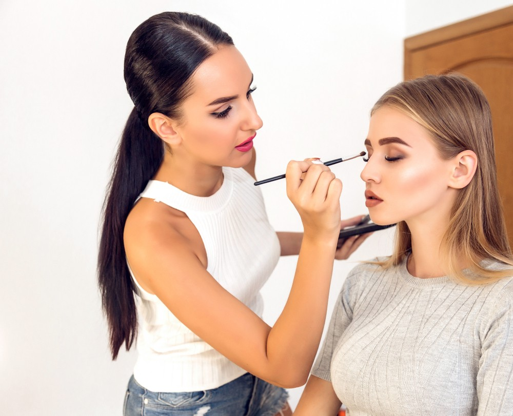 makeup artist doing a client's makeup