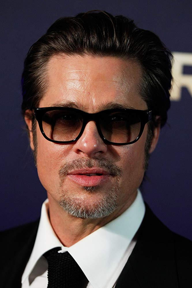 Brad Pitt in sunglasses with a pompadour hairstyle