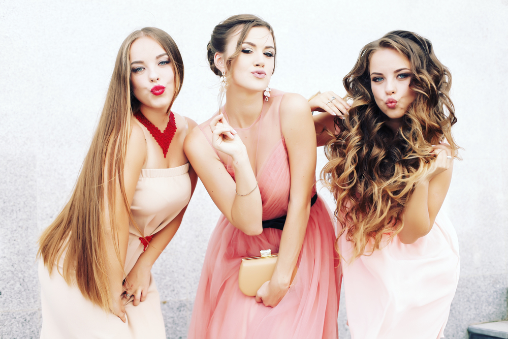 three teen girls getting ready for prom