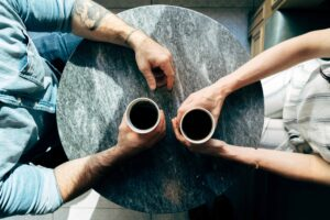 couple having coffee during speed dating