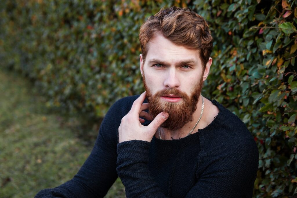 handsome red head male model with a perfectly groomed face