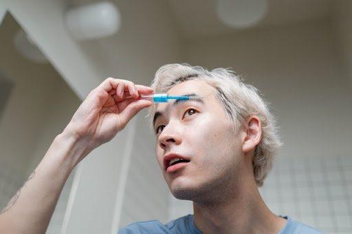 Man doing his eyebrows
