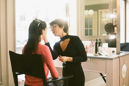 Stylist doing a womans makeup
