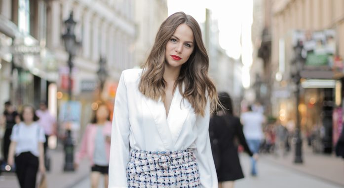 stylish woman standing in the street