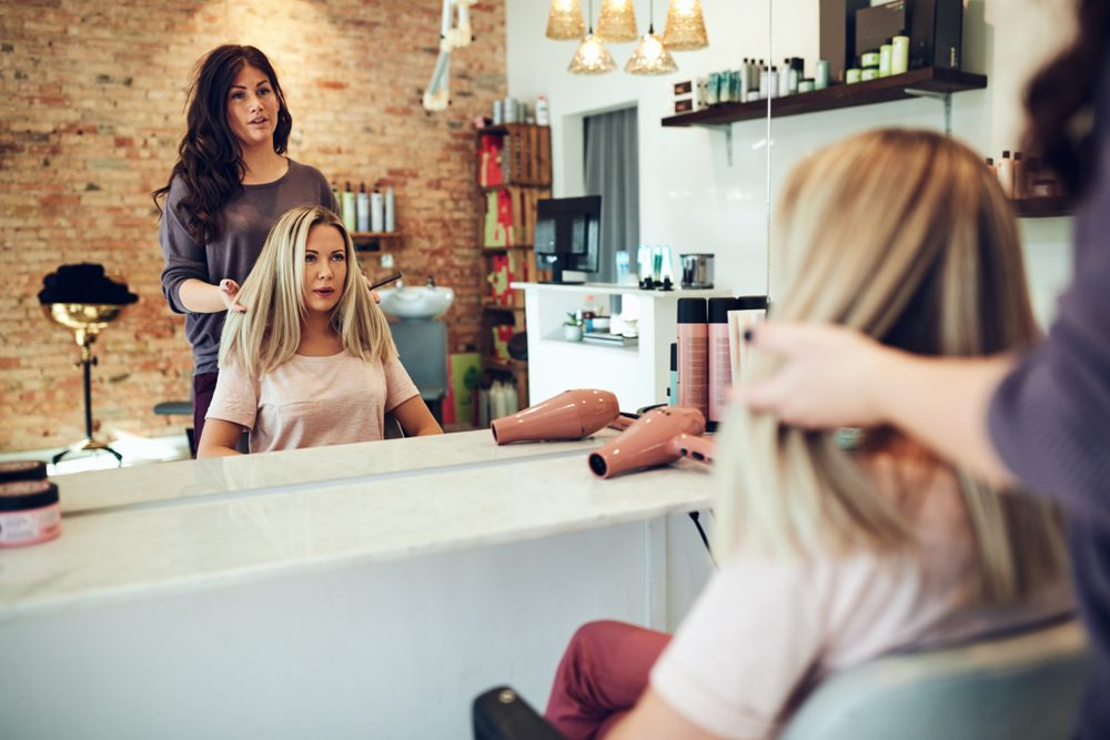 hairstylist talking with client