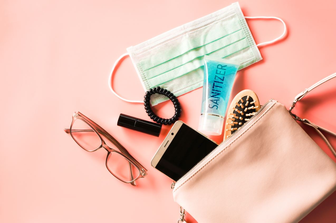 purse with brush, sanitizer, and mask