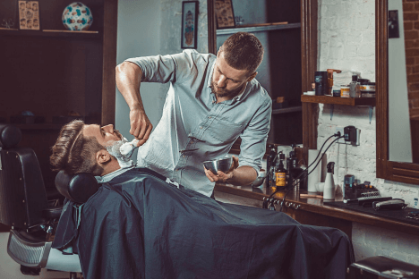 A barber giving a shave