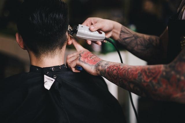 Barber shaving side of client's head