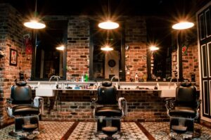 Interior of a barbershop with brick walls